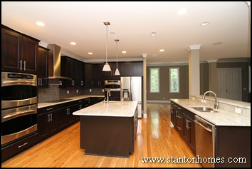 Practical tips to create a better kitchen | Mixing dark kitchen cabinets with light granite