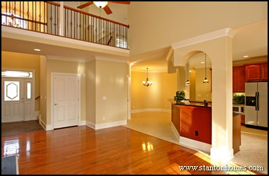 Open floor plan design - how to transition from wood to tile or stone
