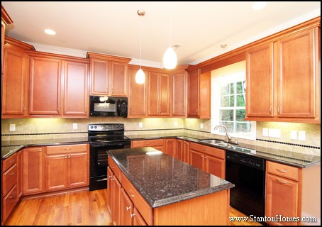 Raleigh custom kitchen color trends light cabinets dark for Kitchen design raleigh