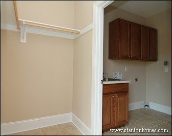 Walk in closet design layout and storage ideas for Masters laundry